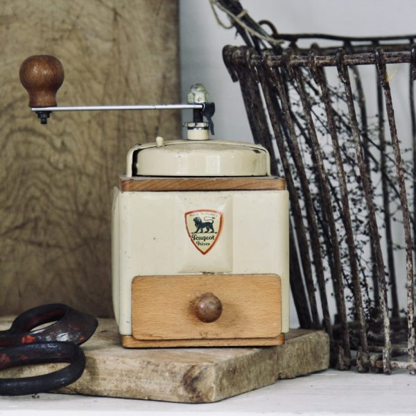 Vintage 'Peugeot Freres' coffee grinder in yellow