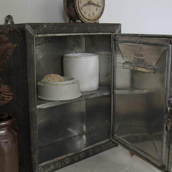 Early 20th century tin mirrored cabinet