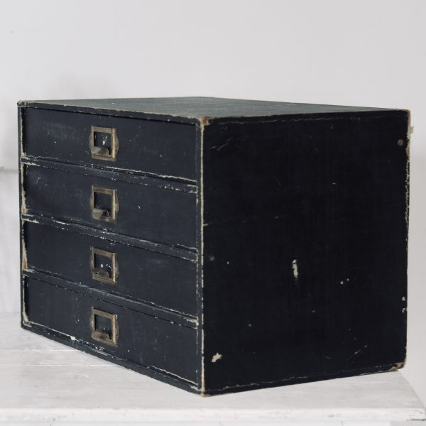 Mid-century little black bank of drawers