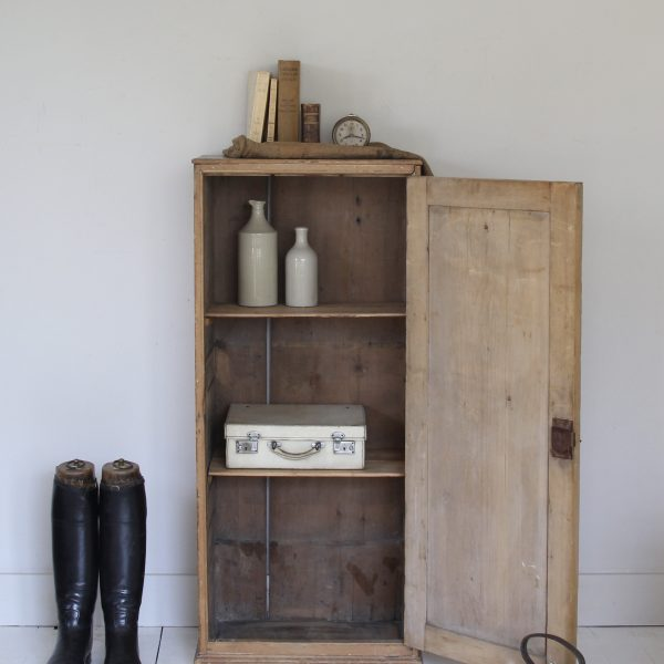 Tall antique pine cupboard