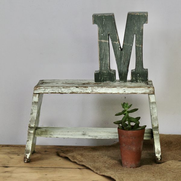 Vintage milking stool in chippy paint